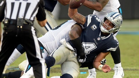 <p>               Dallas Cowboys' Dak Prescott (4) is sacked by Carolina Panthers' Kawann Short (99) during the second half of an NFL football game in Charlotte, N.C., Sunday, Sept. 9, 2018. (AP Photo/Mike McCarn)             </p>