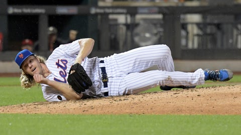 <p>               New York Mets pitcher Noah Syndergaard hits the dirt after being hit on the ribs by a ball hit by Philadelphia Phillies' Cesar Hernandez during the seventh inning of a baseball game Saturday, Sept. 8, 2018, in New York. Syndergaard had to leave the game. (AP Photo/Bill Kostroun)             </p>
