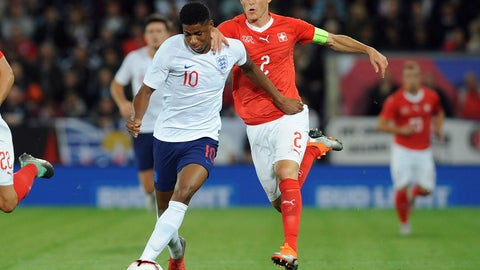 <p>               England's Marcus Rashford, left, and Switzerland's Stephan Lichtsteiner challenge for the ball during the International friendly soccer match between England and Switzerland at the King Power Stadium in Leicester, England, Tuesday, Sept. 11, 2018 . (AP Photo/ Rui Vieira)             </p>