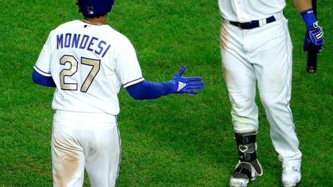 <p>               Kansas City Royals' Adalberto Mondesi (27) is greeted by Alex Gordon (4) after hitting a solo home run during the seventh inning of a baseball game against the Minnesota Twins, Friday, Sept. 14, 2018, in Kansas City, Mo. (AP Photo/Charlie Riedel)             </p>