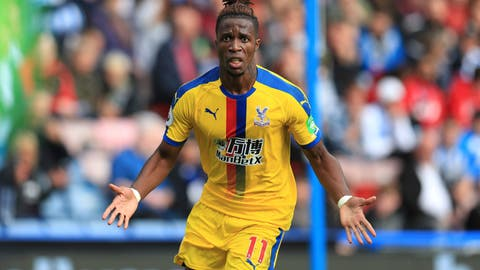 <p>               Crystal Palace's Wilfried Zaha celebrates scoring his side's first goal of the game during the English Premier League soccer match between Huddersfield and Crystal Palace, at the Kirklees Stadium, in Huddersfield, England, Saturday Sept. 15, 2018. (Mike Egerton/PA via AP)             </p>