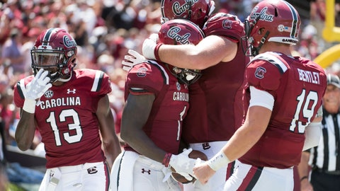 <p>               South Carolina wide receiver Deebo Samuel (1) celebrates his touchdown reception with Blake Camper, right, Jake Bentley (19), and Shi Smith (13) during the second half of an NCAA college football game against Coastal Carolina Saturday, Sept. 1, 2018, in Columbia, S.C. South Carolina defeated Coastal Carolina 49-15. (AP Photo/Sean Rayford)             </p>
