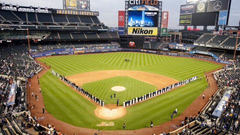 <p>               The Miami Marlins and the New York Mets joins members of the New York police and fire departments on the field for pregame ceremonies before a baseball game Tuesday, Sept. 11, 2018, in New York. (AP Photo/Frank Franklin II)             </p>