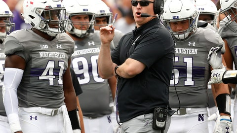 <p>               FILE - In this Sept. 8, 2018, file photo, Northwestern coach Pat Fitzgerald, center, speaks with his team during a break in the play in an NCAA college football game against Duke in Evanston, Ill. Northwestern will try not to make it back-to-back losses when they host Akron on Saturday, Sept. 15, 2018, after having their nine-game win streak last week. (AP Photo/Jim Young, File)             </p>