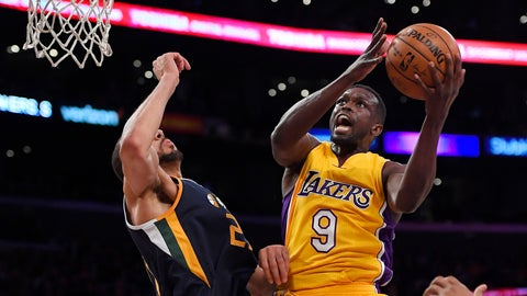 <p>               FILE - In this Tuesday, Dec. 27, 2016 file photo, Los Angeles Lakers forward Luol Deng, right, shoots as Utah Jazz center Rudy Gobert defends during the first half of an NBA basketball game in Los Angeles. The Minnesota Timberwolves have signed free agent forward Luol Deng, the latest former Chicago Bulls player to reunite with coach Tom Thibodeau. Deng's one-year deal is for $2.4 million, according to a person with knowledge of the contract speaking on condition of anonymity to The Associated Press because the team does not release terms(AP Photo/Mark J. Terrill, File)             </p>