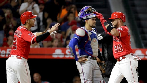 <p>               Los Angeles Angels' Jose Fernandez, right, celebrates after his two-run home run with Andrelton Simmons, left, as Texas Rangers catcher Robinson Chirinos look000s away during the third inning of a baseball game in Anaheim, Calif., Wednesday, Sept. 12, 2018. (AP Photo/Chris Carlson)             </p>