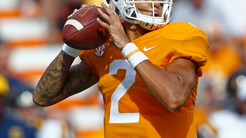 <p>               Tennessee quarterback Jarrett Guarantano (2) looks for a receiver in the first half of an NCAA college football game against East Tennessee State University Saturday, Sept. 8, 2018, in Knoxville, Tenn. (AP Photo/Wade Payne)             </p>