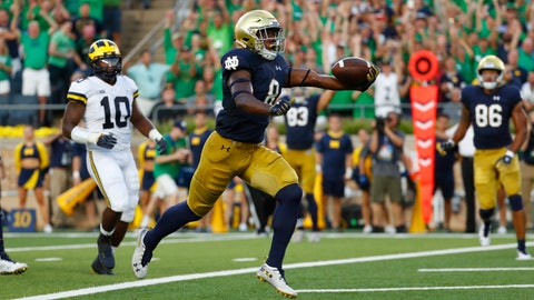 <p>               Notre Dame wide receiver Jafar Armstrong (8) scores a touchdown in front of Michigan linebacker Devin Bush (10) in the first half of an NCAA football game in South Bend, Ind., Saturday, Sept. 1, 2018. (AP Photo/Paul Sancya)             </p>
