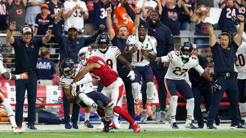 <p>               Players and coaches cheer as Chicago Bears cornerback Bryce Callahan (37) intercepts a pass intended for Arizona Cardinals wide receiver Christian Kirk, who tackles Callahan, during the second half of an NFL football game, Sunday, Sept. 23, 2018, in Glendale, Ariz. (AP Photo/Ralph Freso)             </p>