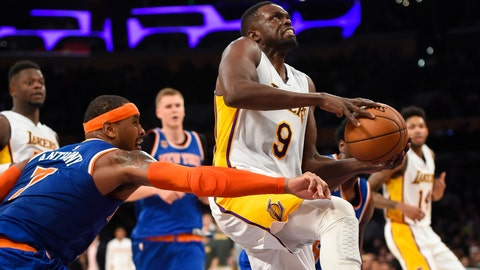 <p>               File-This Dec. 11, 2016, file photo shows Los Angeles Lakers forward Luol Deng (9), of South Sudan, drawing the foul from New York Knicks forward Carmelo Anthony (7) as he drives to the basket during the second half of an NBA basketball game in Los Angeles. The Lakers have waived Deng two years after signing him to a four-year, $72 million free-agent contract. The Lakers announced the move Saturday, Sept. 1, 2018, the first day in which the final season of Deng's mammoth deal could be stretched over a three-season span of the Lakers' salary cap limit.  (AP Photo/Gus Ruelas, File)             </p>