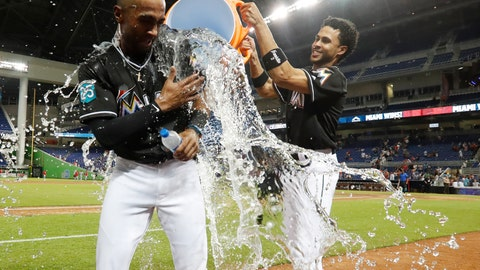 <p>               Miami Marlins' Yadiel Rivera, right, douses Isaac Galloway as Galloway is interviewed after the team defeated the Cincinnati Reds in 10 innings of a baseball game, Friday, Sept. 21, 2018, in Miami. (AP Photo/Wilfredo Lee)             </p>
