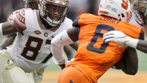 <p>               Florida State's Camren McDonald, left, looks to tackle Syracuse's Antwan Cordy, right, in the first quarter of an NCAA college football game in Syracuse, N.Y., Saturday, Sept. 15, 2018. (AP Photo/Nick Lisi)             </p>