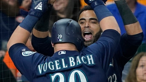 <p>               Seattle Mariners' Daniel Vogelbach (20) celebrates with Nelson Cruz (23) after hitting a grand slam against the Houston Astros during the eighth inning of a baseball game Monday, Sept. 17, 2018, in Houston. (AP Photo/David J. Phillip)             </p>
