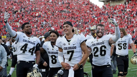 <p>               Colorado players including defensive back Dustin Johnson (26), linebacker Jacob Callier (44), celebrate following an NCAA college football game against Nebraska in Lincoln, Neb., Saturday, Sept. 8, 2018. Colorado won 33-28. (AP Photo/Nati Harnik)             </p>