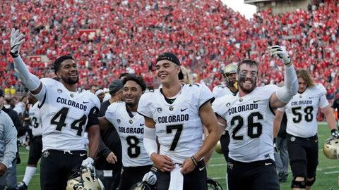 <p>               Colorado players including defensive back Dustin Johnson (26), linebacker Jacob Callier (44), celebrate following an NCAA college football game against Nebraska in Lincoln, Neb., Saturday, Sept. 8, 2018. Colorado won 33-28. (AP Photo/Nati Harnik)             </p>