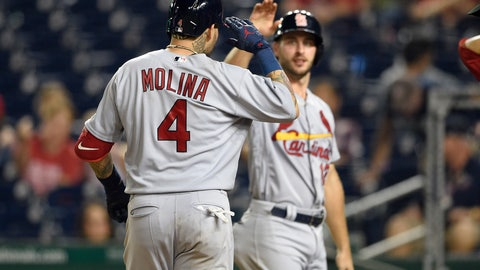 <p>               St. Louis Cardinals' Yadier Molina (4) celebrates his grand slam with Paul DeJong, back, during the ninth inning of a baseball game against the Washington Nationals, Tuesday, Sept. 4, 2018, in Washington. The Cardinals won 11-8. (AP Photo/Nick Wass)             </p>