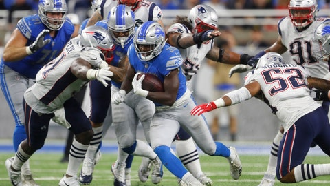 <p>               Detroit Lions running back Kerryon Johnson (33) breaks through the New England Patriots line during the second half of an NFL football game, Sunday, Sept. 23, 2018, in Detroit. (AP Photo/Paul Sancya)             </p>