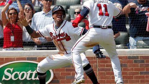 <p>               Atlanta Braves' Ronald Acuna Jr., left, and Ender Inciarte (11) celebrate after scoring on a two-run base hit by Freddie Freeman in the second inning of a baseball game against the Philadelphia Phillies, Saturday, Sept. 22, 2018, in Atlanta. (AP Photo/John Bazemore)             </p>