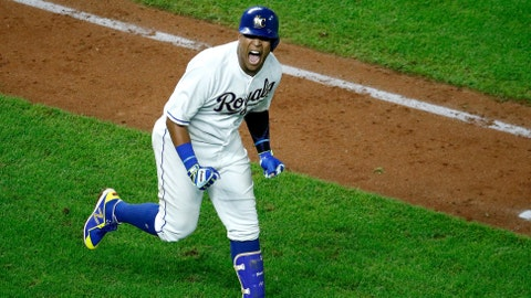 Kansas City Royals' Salvador Perez celebrates after hitting a grand slam in the ninth inning to win a baseball game against the Minnesota Twins Friday, Sept. 14, 2018, in Kansas City, Mo. The Royals won 8-4. (AP Photo/Charlie Riedel)