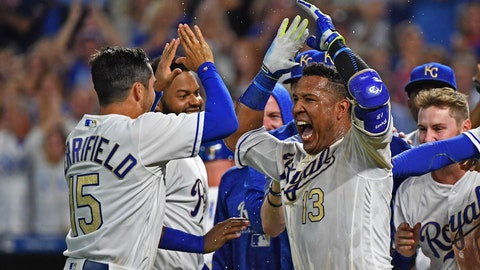 Sep 14, 2018; Kansas City, MO, USA; Kansas City Royals catcher Salvador Perez (13) celebrates with second baseman Whit Merrifield (15) after hitting a walk off grand slam to beat the Minnesota Twins during the ninth inning at Kauffman Stadium. Mandatory Credit: Peter G. Aiken/USA TODAY Sports