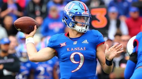 Sep 29, 2018; Lawrence, KS, USA; Kansas Jayhawks quarterback Carter Stanley (9) throws a pass against the Oklahoma State Cowboys in the first half at Memorial Stadium. Mandatory Credit: Jay Biggerstaff-USA TODAY Sports