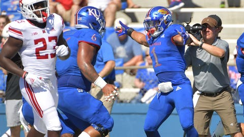 Sep 15, 2018; Lawrence, KS, USA; Kansas Jayhawks safety Bryce Torneden (1) celebrates with defensive tackle Isi Holani (6) after scoring during the first half against the Rutgers Scarlet Knights at Memorial Stadium. Mandatory Credit: Denny Medley-USA TODAY Sports