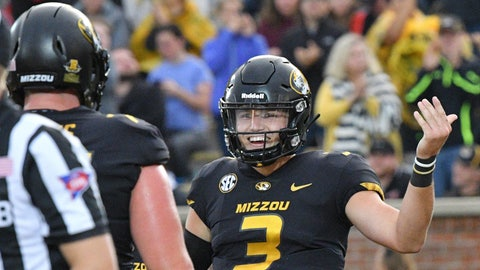 Sep 8, 2018; Columbia, MO, USA; Missouri Tigers quarterback Drew Lock (3) celebrates with Missouri Tigers offensive lineman Paul Adams (77) after scoring a touchdown as during the first half against the Wyoming Cowboys at Memorial Stadium/Faurot Field. Mandatory Credit: Denny Medley-USA TODAY Sports