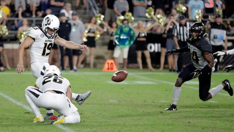 Missouri place kicker Tucker McCann (19) kicks a game-winning, last-second field goal from the hold of Corey Fatony against Purdue in the second half of an NCAA college football game in West Lafayette, Ind., Saturday, Sept. 15, 2018. Missouri defeated Purdue 40-37. (AP Photo/Michael Conroy)
