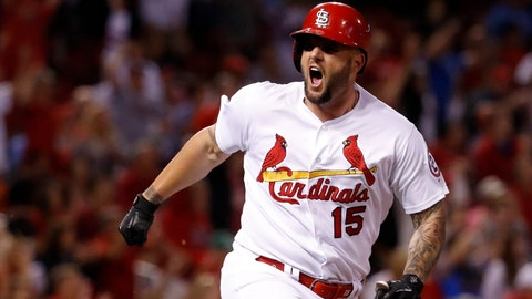St. Louis Cardinals' Matt Adams celebrates after hitting a two-run double during the eighth inning of a baseball game against the San Francisco Giants on Friday, Sept. 21, 2018, in St. Louis. (AP Photo/Jeff Roberson)