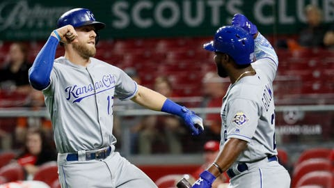 Kansas City Royals' Hunter Dozier, left, celebrates with Brian Goodwin after hitting a go-ahead solo home run off Cincinnati Reds relief pitcher Raisel Iglesias during the ninth inning of a baseball game, Tuesday, Sept. 25, 2018, in Cincinnati. (AP Photo/John Minchillo)