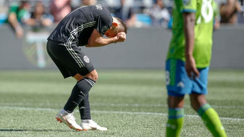 Sep 1, 2018; Seattle, WA, USA; Sporting Kansas City forward Diego Rubio (11) pulls at his hair after missing a shot against the Seattle Sounders FC during the second half at CenturyLink Field. Mandatory Credit: Jennifer Buchanan-USA TODAY Sports