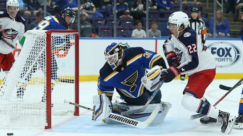St. Louis Blues goaltender Chad Johnson (31) deflects a shot on goal from Columbus Blue Jackets left wing Sonny Milano (22) during the first period of a preseason NHL hockey game Friday, Sept. 21, 2018, in St. Louis. (AP Photo/Scott Kane)
