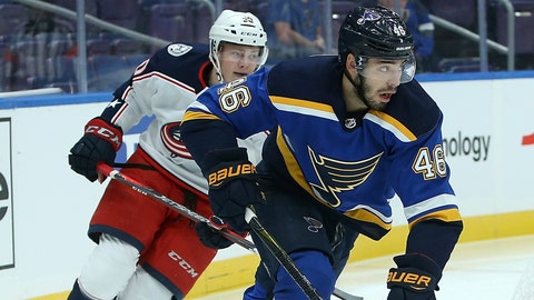 St. Louis Blues defenseman Jake Walman (46) controls the puck in front of Columbus Blue Jackets left wing Eric Robinson (50) during the first period of a preseason NHL hockey game Friday, Sept. 21, 2018, in St. Louis. (AP Photo/Scott Kane)