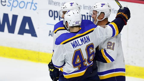 St. Louis Blues center Tyler Bozak, right, celebrates his game wining goal with Robby Fabbri, back, and Jake Walman, front, during the third period of an NHL preseason hockey game, Wednesday, Sept. 19, 2018, in Des Moines, Iowa. St. Louis won 3-2. (AP Photo/Matthew Putney)