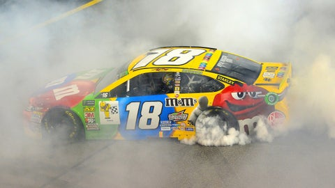 RICHMOND, VA - SEPTEMBER 22:  Kyle Busch, driver of the #18 M&M's Toyota, celebrates with a burnout after winning the Monster Energy NASCAR Cup Series Federated Auto Parts 400 at Richmond Raceway on September 22, 2018 in Richmond, Virginia.  (Photo by Robert Laberge/Getty Images)
