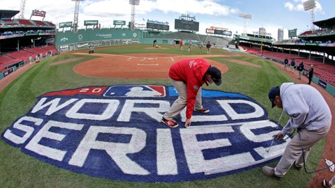 <p>               Grounds crew members paint the World Series logo behind home plate at Fenway Park, Sunday, Oct. 21, 2018, in Boston as they prepare for Game 1 of the baseball World Series between the Boston Red Sox and the Los Angeles Dodgers scheduled for Tuesday. (AP Photo/Elise Amendola)             </p>