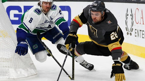 <p>               Vancouver Canucks defenseman Christopher Tanev (8) breaks his stick while battling for the puck with Vegas Golden Knights left wing William Carrier (28) during the second period of an NHL hockey game, Wednesday, Oct. 24, 2018, in Las Vegas. (AP Photo/John Locher)             </p>