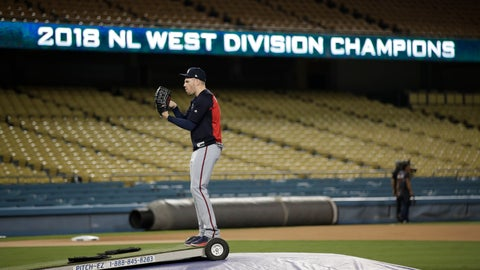 <p>               Atlanta Braves first baseman Freddie Freeman jokingly motions to throw on the mound during baseball practice Wednesday, Oct. 3, 2018, in Los Angeles for Thursday's Game 1 of the team's National League Division Series against the Los Angeles Dodgers. (AP Photo/Jae C. Hong)             </p>