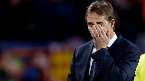 <p>               Real coach Julen Lopetegui gestures as walks off the pitch after losing 5-1 during the Spanish La Liga soccer match between FC Barcelona and Real Madrid at the Camp Nou stadium in Barcelona, Spain, Sunday, Oct. 28, 2018. (AP Photo/Manu Fernandez)             </p>