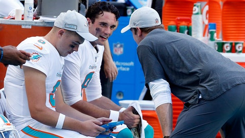 <p>               Miami Dolphins quarterback Brock Osweiler (8), talks to injured quarterback Ryan Tannehill, during the second half of an NFL football game against the Chicago Bears, Sunday, Oct. 14, 2018, in Miami Gardens, Fla. (AP Photo/Joel Auerbach)             </p>