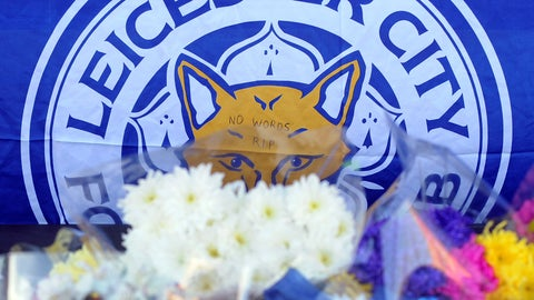 <p>               Tributes are placed outside Leicester City Football Club, Leicester, England, Monday Oct. 29, 2018, after a helicopter crashed in flames Saturday. Vichai Srivaddhanaprabha, the Thai billionaire owner of Premier League team Leicester City was among five people who died after his helicopter crashed and burst into flames shortly after taking off from the soccer field, the club said Sunday. (AP Photo/Rui Vieira)             </p>