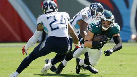 <p>               Philadelphia Eagles tight end Zach Ertz (86) is stopped by Tennessee Titans defenders Kenny Vaccaro (24) and Wesley Woodyard (59) in the first half of an NFL football game Sunday, Sept. 30, 2018, in Nashville, Tenn. (AP Photo/James Kenney)             </p>