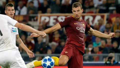 <p>               Roma forward Edin Dzeko, center, shots on goal to score his side second goal during the Champions League, group G soccer match between Roma and Viktoria Plzen at the Rome Olympic Stadium, in Rome, Italy, on Tuesday, Oct. 2, 2018. (AP Photo/Andrew Medichini)             </p>