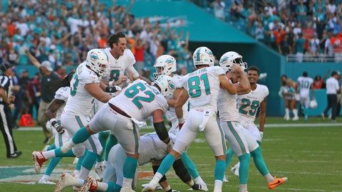 <p>               Miami Dolphins kicker Jason Sanders (7) is congratulated by teammates at the end of overtime at an NFL football game against the Chicago Bears Sunday, Oct. 14, 2018, in Miami Gardens, Fla. The Dolphins defeated the Bears 31-28. Sanders' kick won the game.  (David Santiago/Miami Herald via AP)             </p>