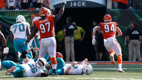 <p>               Cincinnati Bengals defensive end Sam Hubbard (94) returns a fumble by Miami Dolphins quarterback Ryan Tannehill (17) for touchdown during the second half of an NFL football game in Cincinnati, Sunday, Oct. 7, 2018. (AP Photo/Gary Landers)             </p>