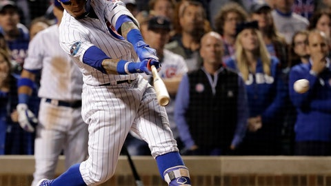 <p>               Chicago Cubs' Javier Baez hits a one-run double during the eighth inning of the National League wild-card playoff baseball game against the Colorado Rockies, Tuesday, Oct. 2, 2018, in Chicago. (AP Photo/Nam Y. Huh)             </p>