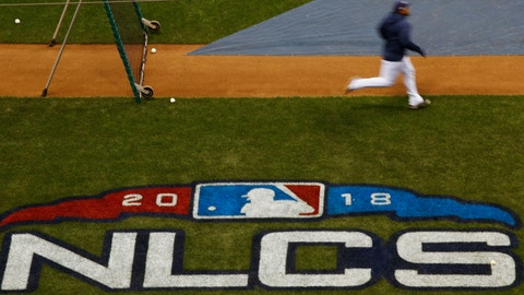 <p>               Milwaukee Brewers' Jesus Aguilar runs bases at practice for Game 1 of the National League Championship Series baseball game against the Los Angeles Dodgers Thursday, Oct. 11, 2018, in Milwaukee. (AP Photo/Charlie Riedel)             </p>