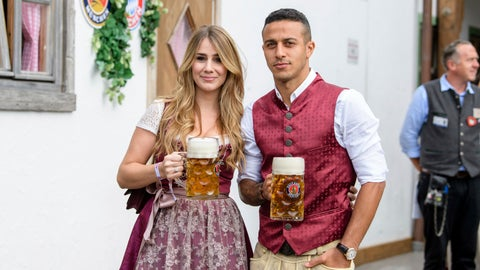 <p>               Thiago, right, player of the German first division, Bundeliga, soccer team FC Bayern Munich, and his wife  Julia Vigas, left, arrive at the 'Oktoberfest' beer festival in Munich, Germany, Sunday, Oct. 7, 2018. (Matthias Balk/dpa via AP)             </p>