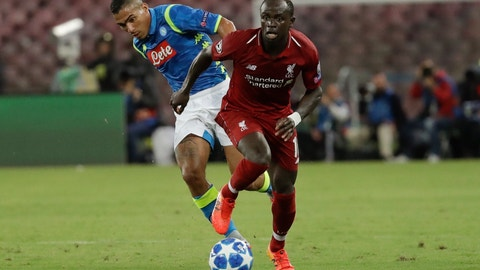 <p>               Liverpool midfielder Sadio Mane, right, and Napoli midfielder Allan vie for the ball during the Champions League, group C soccer match between Napoli and Liverpool, at the San Paolo Stadium in Naples, Italy, Wednesday, Oct. 3, 2018. (AP Photo/Andrew Medichini)             </p>
