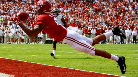 <p>               FILE - In this Sept. 22, 2018, file photo, Alabama wide receiver DeVonta Smith (6) catches a pass for a touchdown during the first half of an NCAA college football game against Texas A&M,  in Tuscaloosa, Ala. No. 1 Alabama has one of the SEC's most talented collection of receivers, and the Crimson Tide is spreading it around among Jerry Jeudy, Henry Ruggs III, DeVonta Smith and Jaylen Waddle. (AP Photo/Butch Dill, File)             </p>
